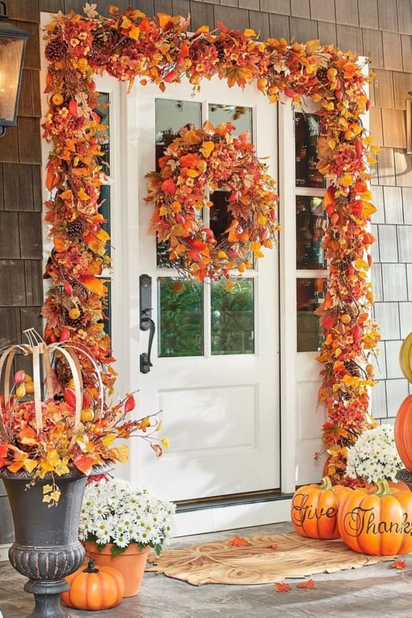 cute fall front door with wreath