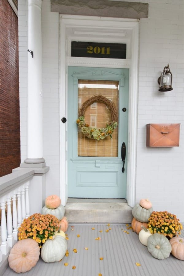 fall porch with blue door