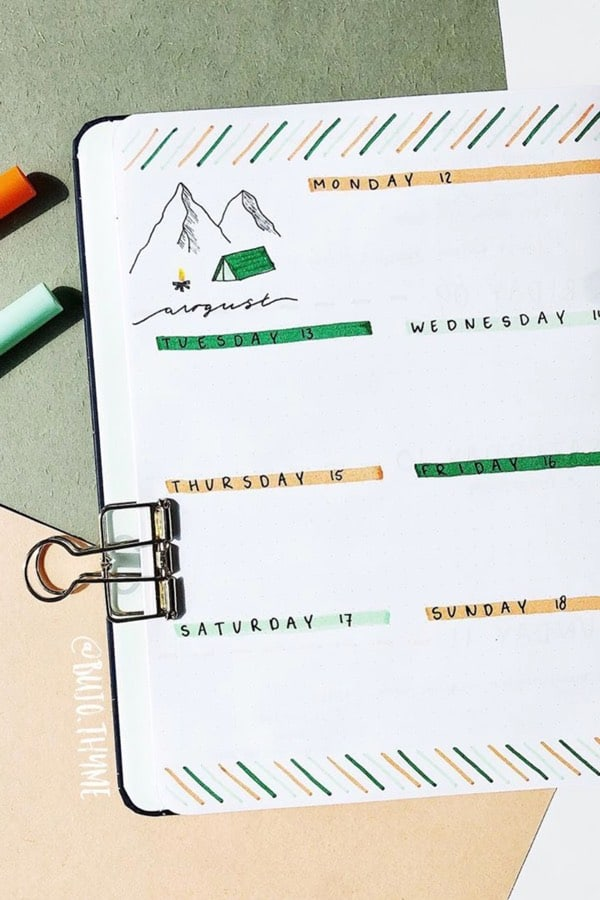 bujo weekly log with camping theme