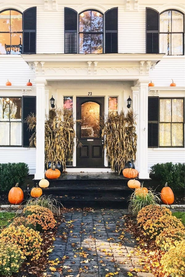 fall porch from white colonial home