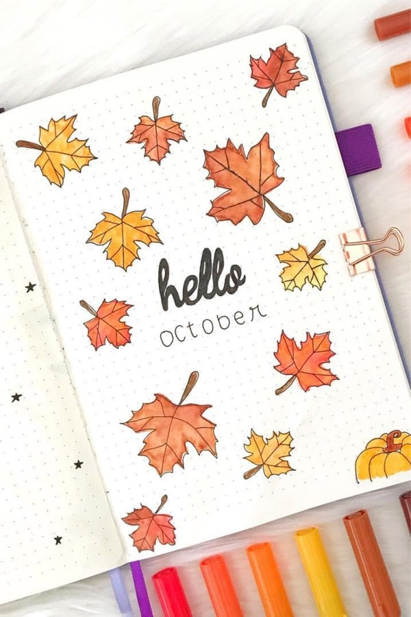 bujo cover spread with fall leaves in orange