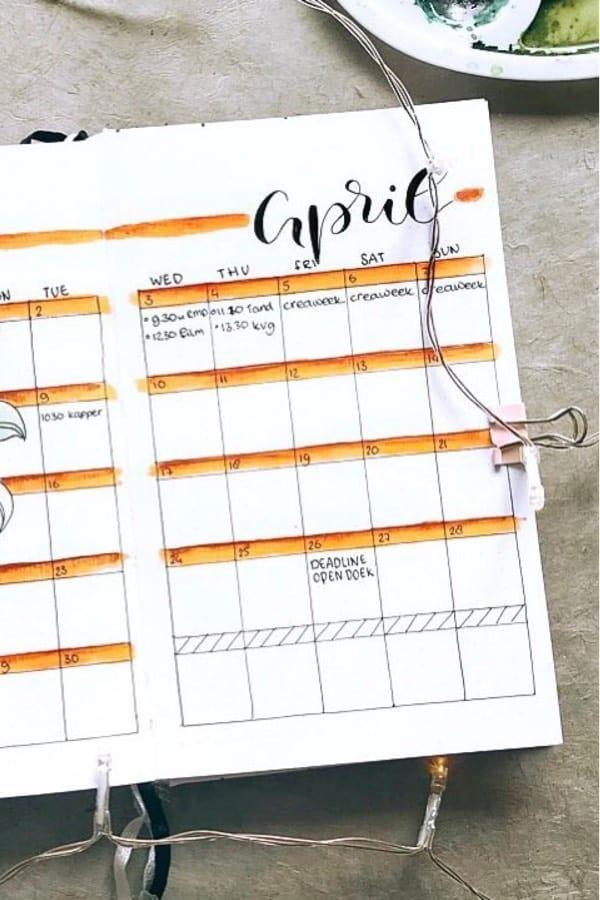 monthly spread with orange headers