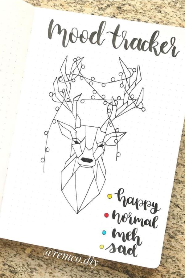 christmas bujo tracker with deer