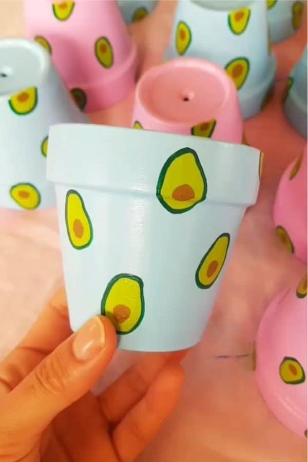 mini clay pot design with avocados