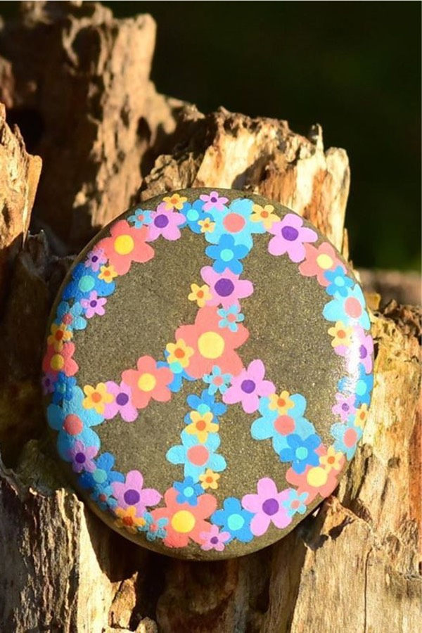 smooth stone with painted flower design