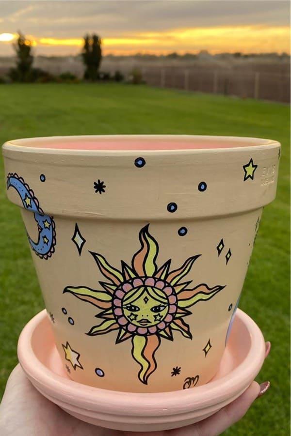 sun and moon themed clay pot design