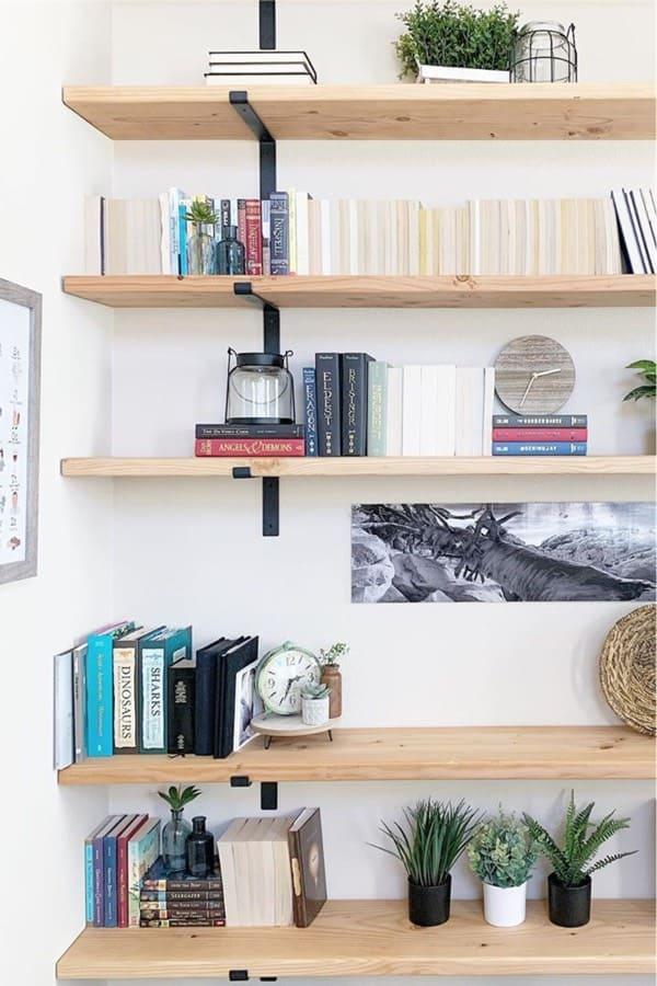 light wood bookshelf with black hangers
