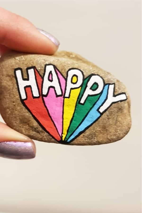 painted rock design with happy quote
