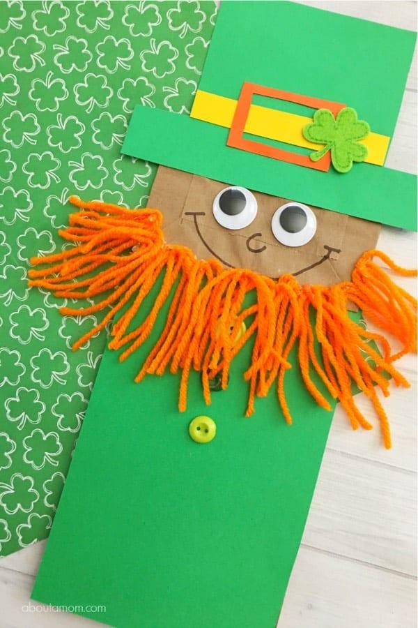 paper bag craft with green leprechaun