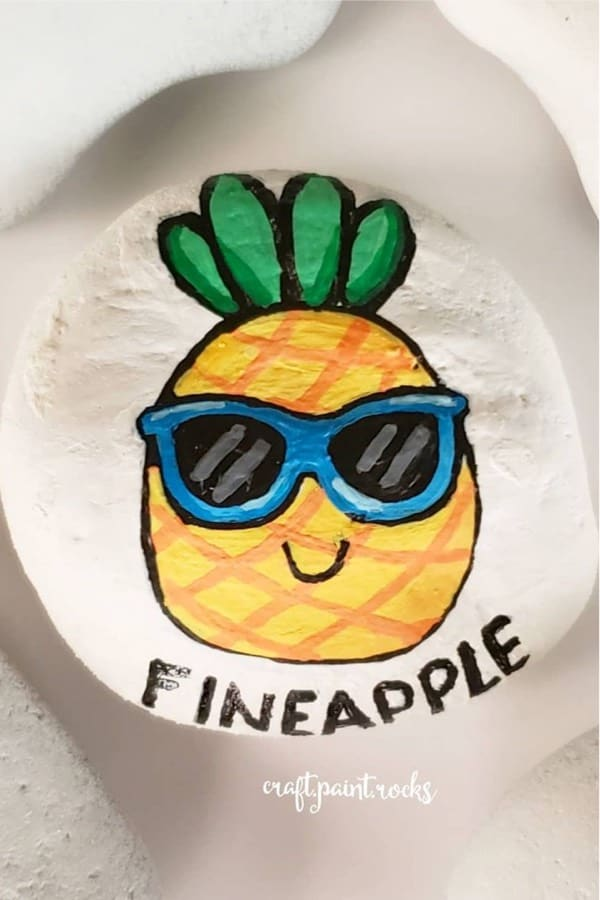 cute painted stone with pineapple face