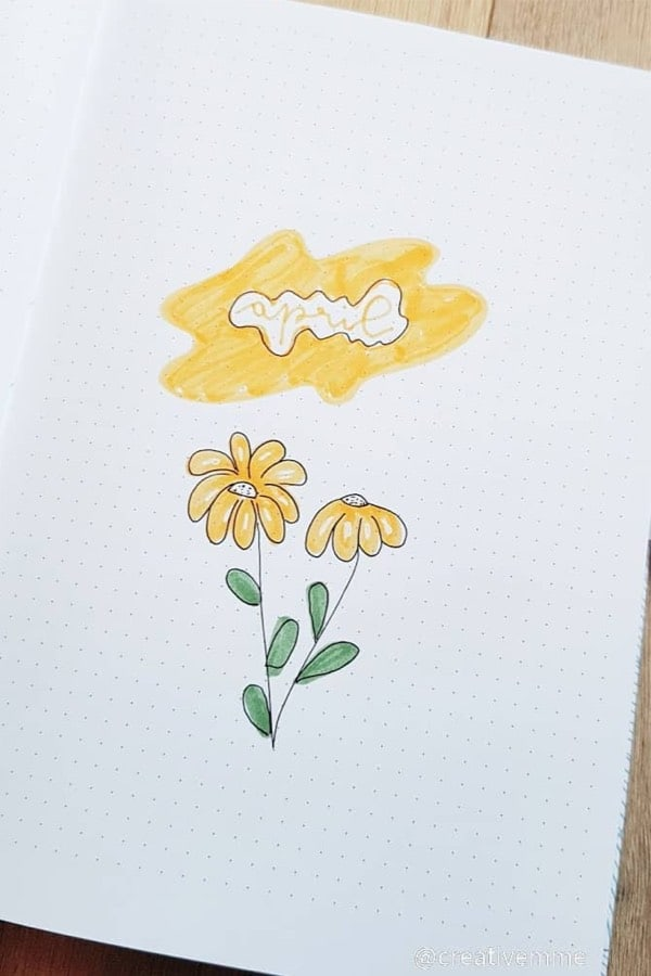 bujo cover spread with yellow flowers