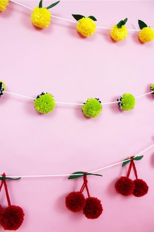 creative yarn garland with pom poms