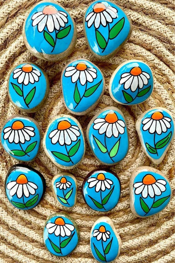 small painted stones with daisy decoartion