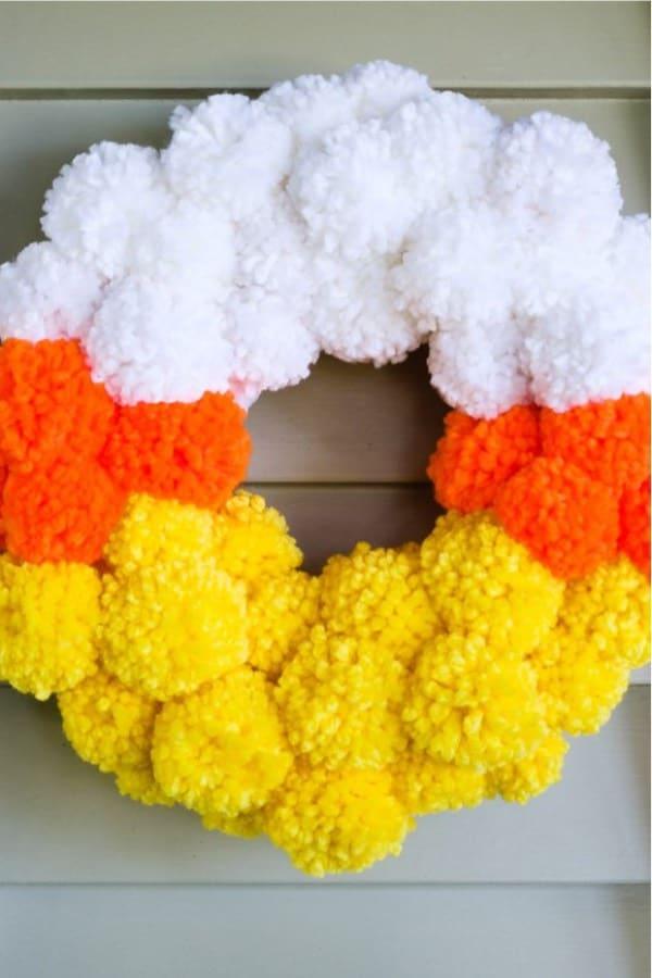 how to make a wreath with yarn pom pom