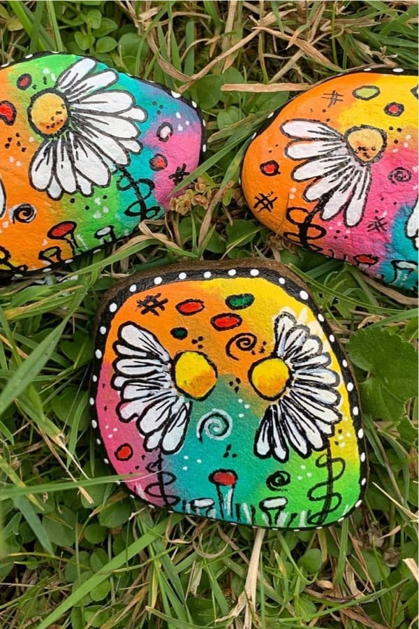 daisy themed painted kindness rock example