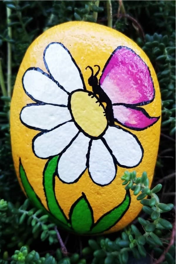 painted stone examples with flower designs