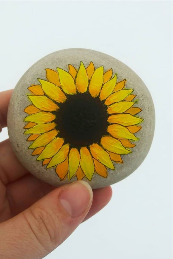 painted kindness rock with sunflower design