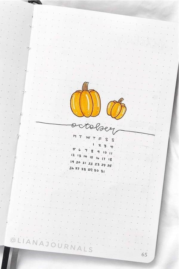 bujo cover spread with pumpkin doodles